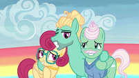 Zephyr and his parents group smile S6E11