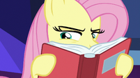 Fluttershy intensely peruses through the books S7E20