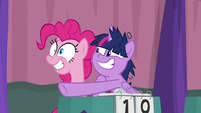 Pinkie Pie looks excitedly at the window S9E16
