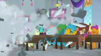 Students shield themselves from debris S8E21