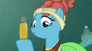 Mage Meadowbrook holding a bottle of honey S7E20.png