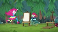 Pinkie runs past festival artist's station EGSBP