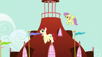 Starburst and Parasol fly through Ponyville S7E1