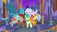 Young Six in a group hug S9E7