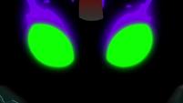 Sombra's eyes appear in the smoke S9E1