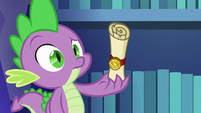Spike looking confused at unfamiliar scroll S6E15