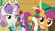 Sweetie Belle and Scootaloo shows Apple Bloom their cutie marks to remind her S6E4.png