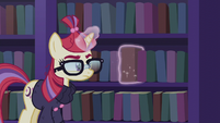 Moon Dancer taking a book off the shelf S5E12