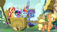 Sunset, Sci-Twi, and RD ride in Applejack's cart EGSB