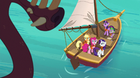 Ponies and Spike look up at the bunyip S6E22