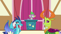 Spike and Ember looking amused at Princess Ember S7E15