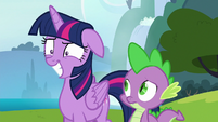 Twilight masking her intense annoyance with a grin S6E25