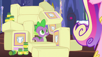 Spike surrounded by diapers and baby food S7E3