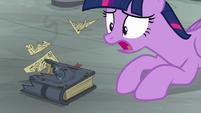 Twilight shocked at Star Swirl's destroyed journal S7E26