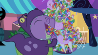 Spike shoveling candy into his mouth S2E4