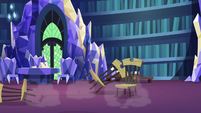 Wooden chairs fall on the library floor S7E15