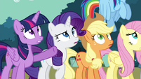 Twilight pointing at mountain of rocks S4E18