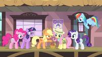 Applejack giving a basket of apples to Fluttershy S4E11