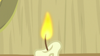 Candle with a burning wick S8E23