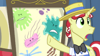 Flim pointing at drawn germs S4E20