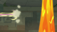 Fluttershy zips away from the lava geysers S9E21