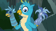 Gallus holding puppets of himself and tree S9E3.png