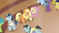 Applejack and Fluttershy enter the resort lobby S6E20