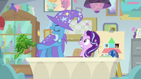 Trixie standing on Starlight's office desk S9E20