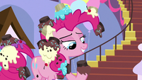 Pinkie Pie with a cupcake on his hoof S9E24