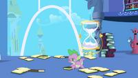 Spike picking up books S1E01