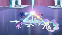 Twilight, Celestia, Luna, and Starlight shooting their magic beams at Crystal Heart S6E2