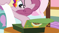 Pinkie Pie reaching for a cookie S6E15
