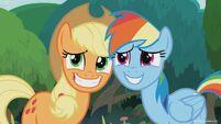 Season 8 promo image - Applejack and Rainbow grinning nervously