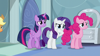 Twilight, Rarity, and Pinkie back away from Rainbow S5E5