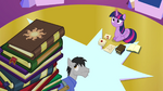 Book with Celestia's cutie mark on top of book pile EG2