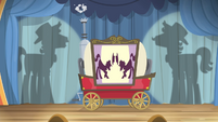 Flim and Flam silhouettes behind the curtain S4E20