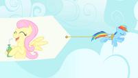 Rainbow Dash pulling banner S1E20