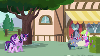 Twilight and Starlight approaching the cafe S7E14