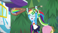 Rainbow Dash excitedly holding a paddle EGSBP