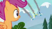 Scootaloo watching the Wonderbolts fly over S7E21
