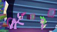 Twilight talking while levitating some books into bookshelf S5E22