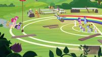 Rainbow Dash zooms around the field S9E15