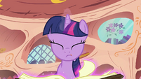 Twilight turning the pages of the book S2E02