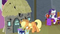 Applejack grabbing a bucket of water S8E7