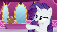 Rarity points at a bag filled with books S5E22