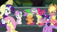 Pinkie speeds away while Spike hangs on S6E7