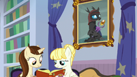Students studying in the school library S8E15