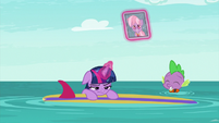 Twilight and Spike floating in the sea S9E5