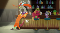 Discord leaning against the jazz club bar S8E10