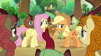 Fluttershy and AJ notice the Kirin approach S8E23